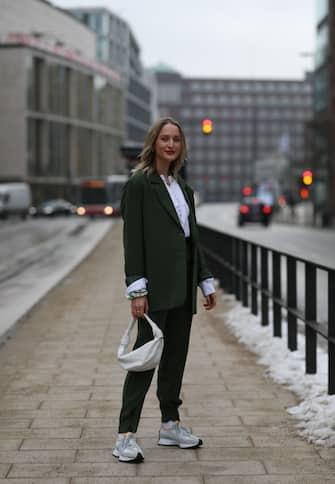 HAMBURG, GERMANY - FEBRUARY 02: Louisa Theresa Grass wearing green Nakd suit, white H&M blouse, New Balance sneaker and beige Bottega Veneta bag on February 02, 2021 in Hamburg, Germany. (Photo by Jeremy Moeller/Getty Images)