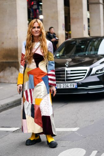 PARIS, FRANCE - FEBRUARY 28: Blanca Miro wears a multicolor patchwork long dress, yellow boots, outside Nina Ricci, during Paris Fashion Week - Womenswear Fall/Winter 2020/2021, on February 28, 2020 in Paris, France. (Photo by Edward Berthelot/Getty Images)