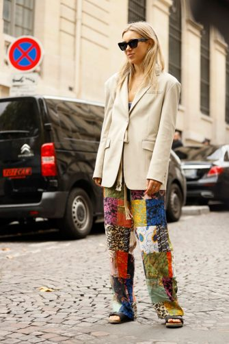 PARIS, FRANCE - SEPTEMBER 28: a guest wearing Ferragamo sunglasses, beige blazer and mixed print pants outside the Altuzarra show during Womenswear Spring/Summer 2020 show Paris Fashion Week on September 28, 2019 in Paris, France. (Photo by Hanna Lassen/Getty Images)