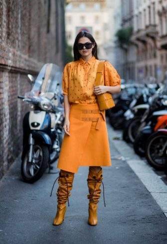 MILAN, ITALY - SEPTEMBER 21: Doina Ciobanu wearing yellow orange blouse and skirt, noots is seen outside Max Mara during Milan Fashion Week Spring/Summer 2018 on September 21, 2017 in Milan, Italy. (Photo by Christian Vierig/Getty Images)