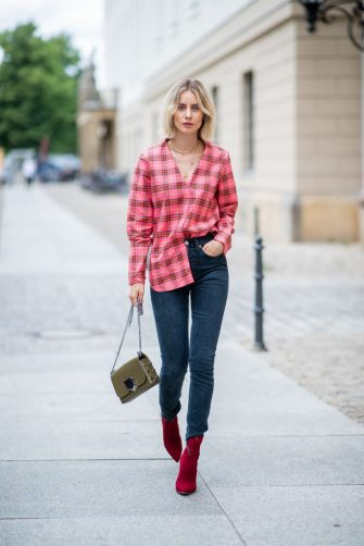 BERLIN, GERMANY - JULY 06: Lisa Hahnbueck wearing plaid Burberry button shirt, dark blue denim jeans Levis Re/done, Jimmy Choo bag, Gianvito Rossi ankle boots during the Berlin Fashion Week July 2018 on July 6, 2018 in Berlin, Germany. (Photo by Christian Vierig/Getty Images)