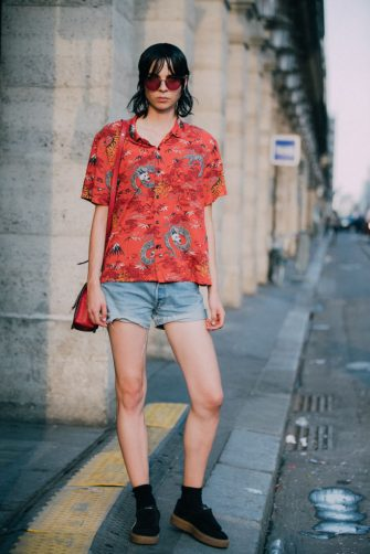 PARIS, FRANCE - JUNE 30:  Model Willy Morsch in an orange print top and jean shorts  outside the Miu Miu Cruise 2019 show on June 30, 2018 in Paris, France.  (Photo by Melodie Jeng/Getty Images)