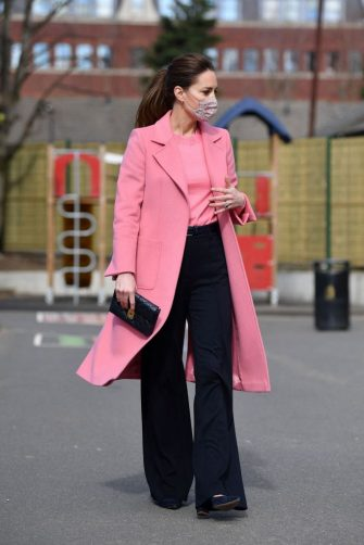 Britain's Catherine, Duchess of Cambridge gestures during a visit to School21 following its re-opening after the easing of coronavirus lockdown restrictions in east London on March 11, 2021. - The visit coincides with the roll-out of Mentally Healthy Schools resources for secondary schools and how this is helping put mental health at the heart of their schools curriculum. (Photo by JUSTIN TALLIS / various sources / AFP) (Photo by JUSTIN TALLIS/AFP via Getty Images)