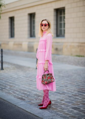 BERLIN, GERMANY - MAY 23: Sonia Lyson wearing pink ruffled dress Topshop, Gucci knee socks, pink Manolo Blahnik shoes, Fendi bag, Zara sunglasses on May 23, 2018 in Berlin, Germany. (Photo by Christian Vierig/Getty Images)