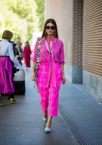 MILAN, ITALY - SEPTEMBER 21: Negin Mirsalehi wearing pink blouse, pink checked cropped pants is seen outside Fendi during Milan Fashion Week Spring/Summer 2018 on September 21, 2017 in Milan, Italy. (Photo by Christian Vierig/Getty Images)
