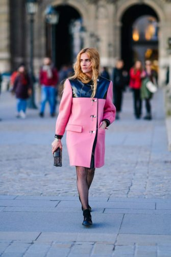 PARIS, FRANCE - MARCH 03: Blanca Miro wears a pink coat, a Vuitton monogram clutch, tights, black shoes, outside Vuitton, during Paris Fashion Week - Womenswear Fall/Winter 2020/2021 on March 03, 2020 in Paris, France. (Photo by Edward Berthelot/Getty Images)