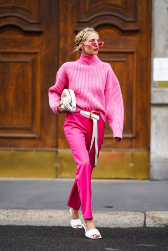MILAN, ITALY - SEPTEMBER 22:  Leonie Hanne wears pink sunglasses, a pink wool turtleneck pullover, a white bag, a white belt, pink pants, white sandals, outside the Boss show during Milan Fashion Week Spring/Summer 2020 on September 22, 2019 in Milan, Italy. (Photo by Edward Berthelot/Getty Images)