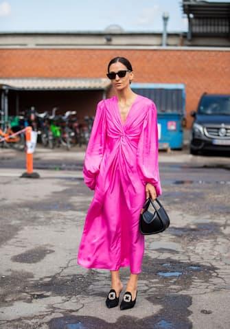 COPENHAGEN, DENMARK - AUGUST 08: A guest is seen wearing pink dress outside By Malene Birger during Copenhagen Fashion Week Spring/Summer 2020 on August 08, 2019 in Copenhagen, Denmark. (Photo by Christian Vierig/Getty Images)