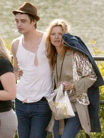 Kate Moss and Pete Doherty during 2005 Isle Of Wight Festival - Day 2 - Backstage at Seaclose Park in Newport, Great Britain. (Photo by Paul Underhill/FilmMagic)