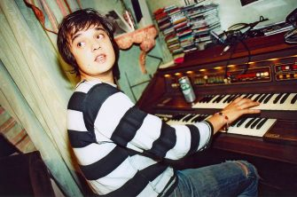 UNITED KINGDOM - MAY 01:  Photo of Pete DOHERTY and LIBERTINES; Pete Doherty, playing organ in the Albion Rooms - Pete Doherty and Carl Barat's Bethnal Green flat  (Photo by Patrick Ford/Redferns)