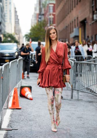 NEW YORK, NEW YORK - SEPTEMBER 09: Nina Agdal is seen wearing wrapped dress, overknees boots with floral print outside Zimmermann during New York Fashion Week September 2019 on September 09, 2019 in New York City. (Photo by Christian Vierig/Getty Images)