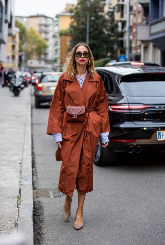 MILAN, ITALY - SEPTEMBER 19: Candela Novembre is seen wearing rusty brown trench coat, belt bag, blue button shirt outside the Max Mara show during Milan Fashion Week Spring/Summer 2020 on September 19, 2019 in Milan, Italy. (Photo by Christian Vierig/Getty Images)