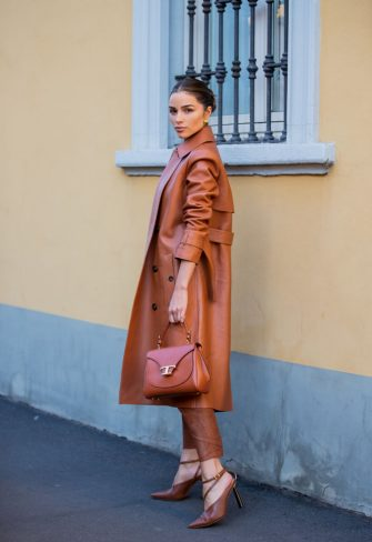 MILAN, ITALY - FEBRUARY 21: Olivia Culpo is seen wearing rust brown coat and pants, sheer top outside Tods during Milan Fashion Week Fall/Winter 2020-2021 on February 21, 2020 in Milan, Italy. (Photo by Christian Vierig/Getty Images)