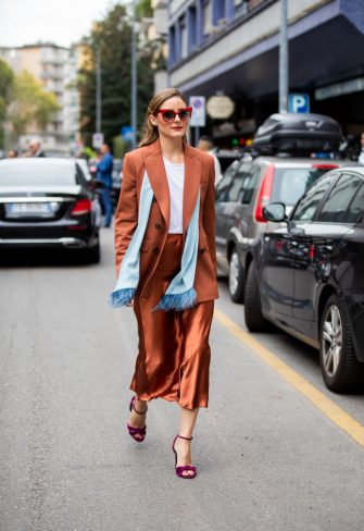 MILAN, ITALY - SEPTEMBER 19: Olivia Palermo is seen wearing rusty brown silk skirt, turquois scarf, blazer, purple heels, white shirt outside the Max Mara show during Milan Fashion Week Spring/Summer 2020 on September 19, 2019 in Milan, Italy. (Photo by Christian Vierig/Getty Images)