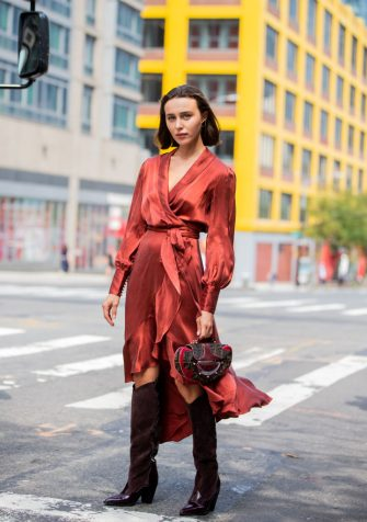 NEW YORK, NEW YORK - SEPTEMBER 09: Mary Leest is seen wearing Fendi bag, silk dress, bordeaux boots outside Zimmermann during New York Fashion Week September 2019 on September 09, 2019 in New York City. (Photo by Christian Vierig/Getty Images)