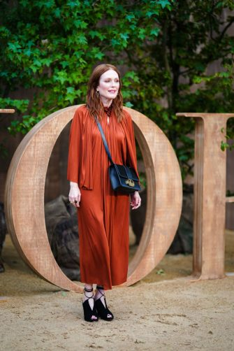 PARIS, FRANCE - SEPTEMBER 24: Julianne Moore wears a frilly collar rust-color pleated dress, a Dior bag, outside Dior during Paris Fashion Week - Womenswear Spring Summer 2020, on September 24, 2019 in Paris, France. (Photo by Edward Berthelot/Getty Images)