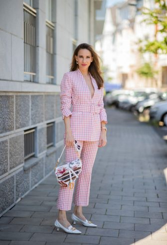 DUSSELDORF, GERMANY - JULY 15: Alexandra Lapp is seen wearing red checkered suit ZARA, shoes Bottega Veneta pumps BV Madame in white, Saddle bag from Dior on July 15, 2020 in Dusseldorf, Germany. (Photo by Christian Vierig/Getty Images)