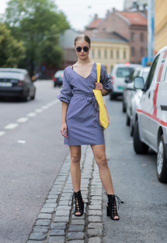 OSLO, NORWAY - AUGUST 24: Model Lea Meyer wearing a plaid dress, yellow bag, black sandals outside Vanessa Rudjord on August 24, 2017 in Oslo, Norway. (Photo by Christian Vierig/Getty Images)