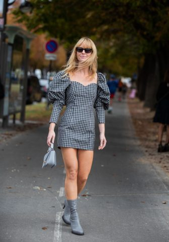 PARIS, FRANCE - SEPTEMBER 26: Jeanette Friis Madsen wearing grey checkered dress, bag, ankle boots seen outside Y/Project during Paris Fashion Week Womenswear Spring Summer 2020 on September 26, 2019 in Paris, France. (Photo by Christian Vierig/Getty Images)