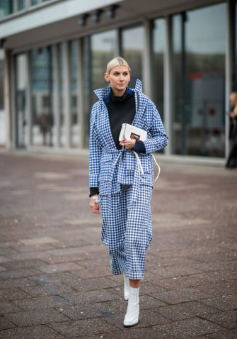 BERLIN, GERMANY - JANUARY 16:  Kimyana Hachmann is seen wearomg turtleneck, white boots, blue plaid jacket and pants, white bag during the Berlin Fashion Week Autumn/Winter 2019 on January 16, 2019 in Berlin, Germany. (Photo by Christian Vierig/Getty Images)