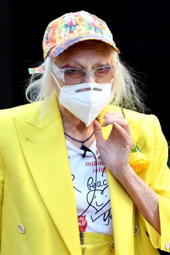 LONDON, ENGLAND - JULY 21: Dame Vivienne Westwood wears a face covering outside the Old Bailey on July 21, 2020 in London, England. Dame Vivienne Westwood, re-entering public life for the first time after having been shielding for 16 weeks during the COVID-19 lockdown, suspends in giant birdcage in front of The Old Bailey Criminal Court, in protest about the illegal U.S. extradition of Julian Assange for telling the truth about American war crimes. (Photo by Gareth Cattermole/Getty Images)