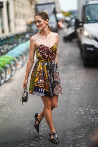 PARIS, FRANCE - JULY 01: Sofia Sanchez de Betak wears necklaces, a colorful African design wax Dior bustier dress, a python pattern Dior bag, black T-strap pointy heeled sandals, outside Dior, during Paris Fashion Week -Haute Couture Fall/Winter 2019/2020, on July 01, 2019 in Paris, France. (Photo by Edward Berthelot/Getty Images)