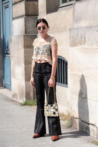 PARIS, FRANCE - JULY 01: Art director Madelynn Furlong wears a Paco Rabanne bag, Dundas top, Gucci trousers and Chloe boots on July 01, 2019 in Paris, France. (Photo by Kirstin Sinclair/Getty Images)