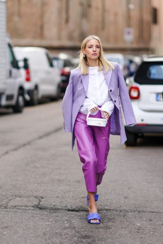 MILAN, ITALY - FEBRUARY 20: Leonie Hanne wears a mauve oversized blazer jacket, a white shirt, a white bag from Jacquemus, purple leather cropped pants, blue quilted sandals, outside Max Mara, during Milan Fashion Week Fall/Winter 2020-2021 on February 20, 2020 in Milan, Italy. (Photo by Edward Berthelot/Getty Images)