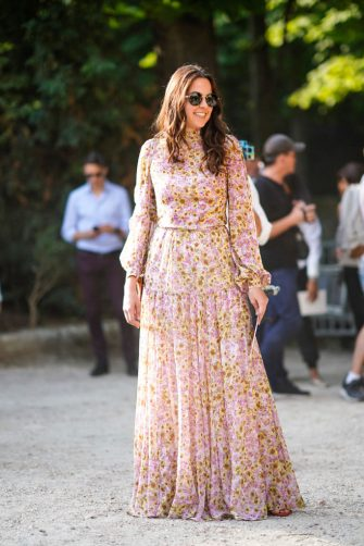 PARIS, FRANCE - JULY 02: Anouchka Delon wears a pink flower print pleated dress, outside Giambattista Valli, during Paris Fashion Week Haute Couture Fall Winter 2018/2019, on July 2, 2018 in Paris, France.  (Photo by Edward Berthelot/Getty Images)