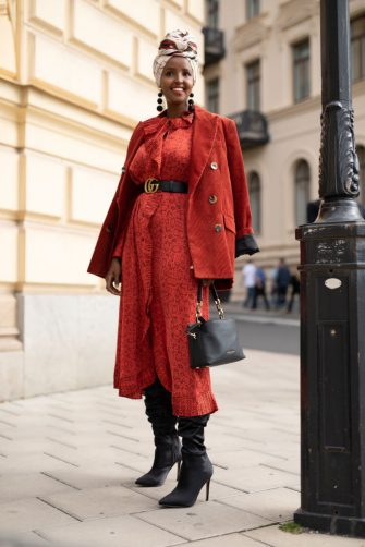 STOCKHOLM, SWEDEN - AUGUST 29:  A guest is seen on the street during Fashion Week Stockholm SS19 wearing a rust corduroy jacket with rust dress on August 29, 2018 in Stockholm, Sweden.  (Photo by Matthew Sperzel/Getty Images)