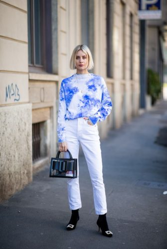 MILAN, ITALY - FEBRUARY 24: Lisa Hahnbueck is seen wearing blue jumper Balmain, white jeans Redone, Boyy bag, Roger Vivier velvet heels on Day 5 Milan Fashion Week Autumn/Winter 2019/20 on February 24, 2019 in Milan, Italy. (Photo by Christian Vierig/Getty Images)