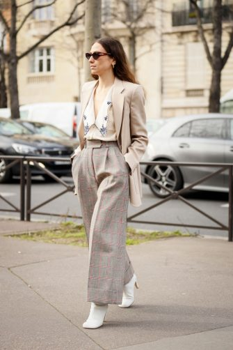 PARIS, FRANCE - MARCH 03: Erika Boldrin wearing Miu Miu jacket, plaid pants, white boots  and embroidery shirt outside the Miu Miu show during Paris Fashion Week Womenswear Fall/Winter 2020/2021 Day Nine on March 03, 2020 in Paris, France. (Photo by Hanna Lassen/Getty Images)