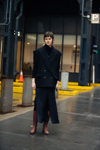 NEW YORK, NEW YORK - FEBRUARY 10: Model Jamily Wernke Meurer wears a total look by Brazilian designer Gloria Coelho - an oversized black blazer, black pleated skirt, and brown boots after the Dion Lee show  on February 10, 2020 in New York City. (Photo by Melodie Jeng/Getty Images)