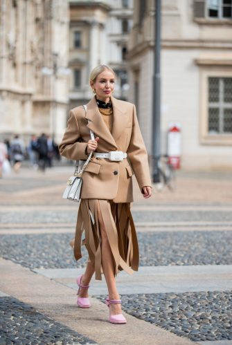 MILAN, ITALY - SEPTEMBER 24: Leonie Hanne seen wearing total look Prada: brown blazer and ripped skirt, white belt bag, white bag, pink heels during the Milan Women's Fashion Week on September 24, 2020 in Milan, Italy. (Photo by Christian Vierig/Getty Images)
