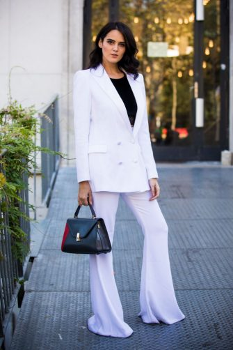 PARIS, FRANCE - SEPTEMBER 26:  Catherine Poulain, wearing a total white suits and a black leather bag, is seen before the Dries Van Noten show on September 26, 2018 in Paris, France. (Photo by Claudio Lavenia/Getty Images)