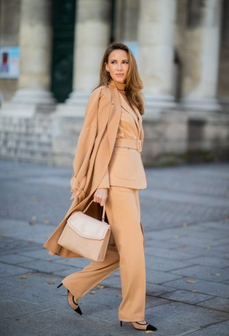 PARIS, FRANCE - SEPTEMBER 23: Alexandra Lapp is seen wearing a toffee colored total look from Marc Cain with belted blazer and wool-cashmere coat, bag and shoes during Paris Fashion Week Womenswear Spring Summer 2020 on September 23, 2019 in Paris, France. (Photo by Christian Vierig/Getty Images)