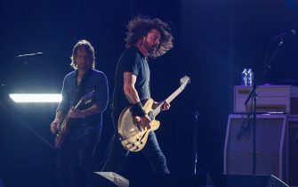 "Dave Grohl (R) and Chris Shiflett of US rock band the Foo Fighters perform onstage during the taping of the ""Vax Live"" fundraising concert at SoFi Stadium in Inglewood, California, on May 2, 2021. - The fundraising concert ""Vax Live: The Concert To Reunite The World"", put on by international advocacy organization Global Citizen, is pushing businesses to ""donate dollars for doses,"" and for G7 governments to share excess vaccines. The concert will be pre-taped on May 2 in Los Angeles, and will stream on YouTube along with American television networks ABC and CBS on May 8. (Photo by VALERIE MACON / AFP) (Photo by VALERIE MACON/AFP via Getty Images)"