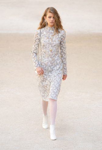 UNSPECIFIED, UNSPECIFIED: (EDITORS NOTE: This picture may only be used in the context of an editorial feature on the CHANEL Cruise 2021/22 show) In this handout released on May 14th, a model walks the runway during the Chanel Cruise 2021/2022 Collection Show at the Carrières de Lumières in Les Baux-de-Provence, France. (Photo by Handout/Getty Images)