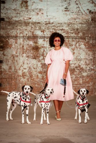 SYDNEY, AUSTRALIA - JUNE 02: Aicha Robertson poses with three Dalmatian dogs and wearing Aje dress, Wittner shoes, Amber Sceats shoes at Afterpay Australian Fashion Week 2021 on June 02, 2021 in Sydney, Australia. (Photo by Hanna Lassen/Getty Images)