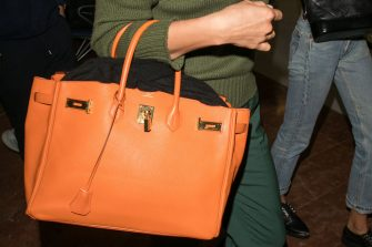 NICE, FRANCE - MAY 09: Model Irina Shayk, Hermes Birkin handbag detail, is seen during the 71st annual Cannes Film Festival at Nice Airport on May 9, 2018 in Nice, France.  (Photo by Marc Piasecki/GC Images)