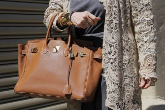 NEW YORK, NY - SEPTEMBER 14: Elida Olsen is seen on the streets of Manhattan outside of the Lela Rose Spring 2016 fashion show at Skylight at Clarkson Sq wearing Dior grey pants, Ralph Lauren lace cardigan and tan leather Hermes Birkin bag on September 14, 2015 in New York City.  (Photo by Georgie Wileman/Getty Images)