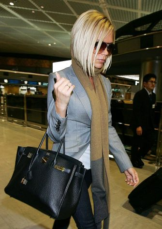 NARITA, JAPAN - SEPTEMBER 27:  Victoria Beckham arrives at New Tokyo International Airport on September 27, 2007 in Narita, Japan. Victoria is travelling back to London following Ted Beckham's heart attack.  (Photo by Junko Kimura/Getty Images)