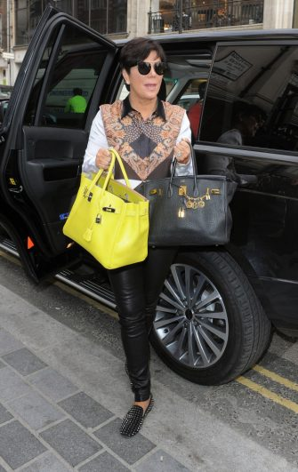 LONDON, ENGLAND - APRIL 24: Kris Jenner with two Hermes Birkin handbags worth almost £15000 each on April 24, 2013 in London, England. (Photo by Will/GC Images)