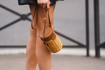 PARIS, FRANCE - MARCH 03: A guest wears a wooden cylinder shaped bag with a brown leather part, outside Miu Miu, during Paris Fashion Week - Womenswear Fall/Winter 2020/2021 on March 03, 2020 in Paris, France. (Photo by Edward Berthelot/Getty Images)