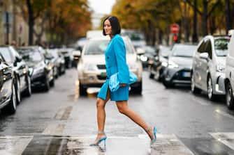 PARIS, FRANCE - OCTOBER 01: Tiffany Hsu wears a blue oversized jacket dress, a blue bag, blue heels shoes, outside Miu Miu, during Paris Fashion Week - Womenswear Spring Summer 2020, on October 01, 2019 in Paris, France. (Photo by Edward Berthelot/Getty Images)