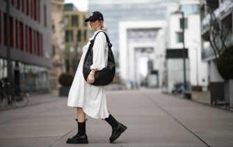 COLOGNE, GERMANY - MARCH 07: Kathrin Bommann (viva_la_wow) wearing Pixie Shop dress, Bottega Veneta boots, Frankie Shop bag and, New Era cap on March 07, 2020 in Cologne, Germany. (Photo by Jeremy Moeller/Getty Images)
