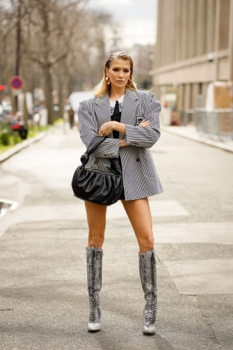 PARIS, FRANCE - MARCH 03: Elena Perminova is seen wearing a Miu Miu black and white jacket, lace up boots and black bag outside the Miu Miu show during Paris Fashion Week Womenswear Fall/Winter 2020/2021 Day Nine on March 03, 2020 in Paris, France. (Photo by Hanna Lassen/Getty Images)