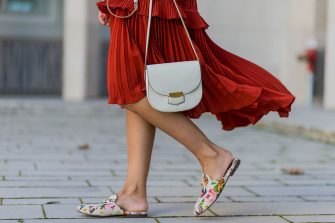 COLOGNE, GERMANY - August 25: Golestaneh Mayer-Uellner (@golestaneh) wearing a red plissee dress with ruffles from Self Portrait, Canvas Princetown slipper with floral print from Gucci Garden, white trotteur bag from Celine, August 25, 2016 in Cologne, Germany. (Photo by Christian Vierig/Getty Images)