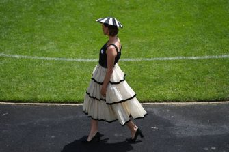A racegoer attends the second day of the Royal Ascot horse racing meet, in Ascot, west of London on June 16, 2021. - Royal Ascot reopened its doors Tuesday to 12,000 racing fans a day but the coronavirus will still take a significant financial toll on the event. (Photo by DANIEL LEAL-OLIVAS / AFP) (Photo by DANIEL LEAL-OLIVAS/AFP via Getty Images)