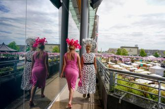 ASCOT, ENGLAND - JUNE 16: A general view as two ladies make their way into the grandstand on Day Two of the Royal Ascot Meeting at Ascot Racecourse on June 16, 2021 in Ascot, England. A total of twelve thousand racegoers made up of owners and the public are permitted to attend the meeting due to it being an Events Research Programme (ERP) set up by the Government due to the Coronavirus pandemic. (Photo by Alan Crowhurst/Getty Images)